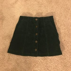 Dark green corduroy skirt with button front